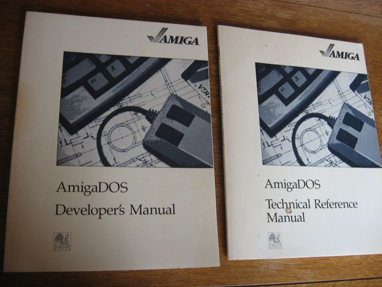 Amiga DOS Developer's Manual; AND, AmigaDOS Technical Reference Manual (two manuals). var Amiga.
