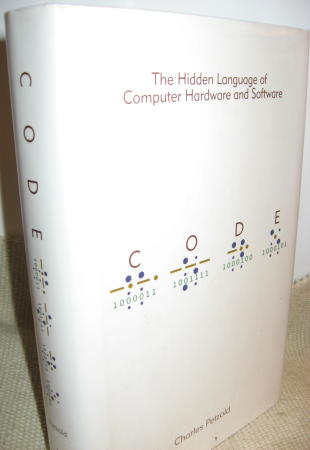Code -- The Hidden Language of Computer Hardware and Software. Charles Petzold.