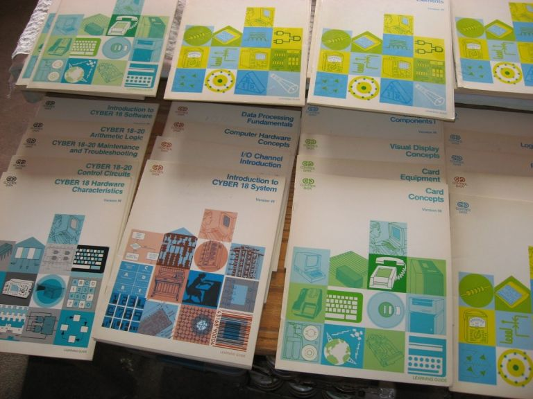 52 booklets CYBER 18-20 reference manuals, learning guides 1979 self-paced questions/exercises/answers; Weight approx. 23 lbs. Control Data Corporation.