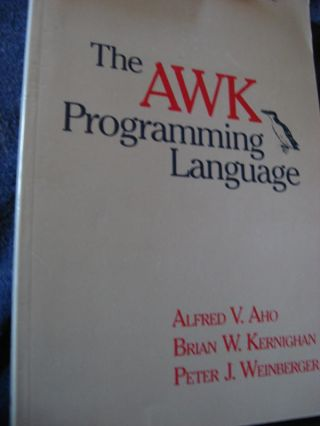 The AWK Programming Language. Alfred Aho, Brian W. Kernighan, Peter Weinberger.