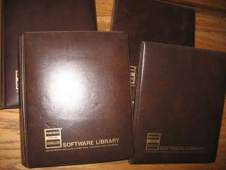 Software Library -- TRS-80; 4 softsided binders containing manuals and some cassette tapes